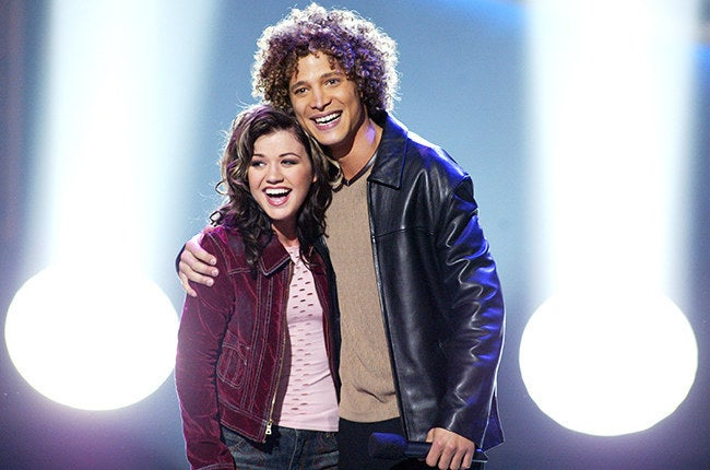 For those of you who don't remember, Justin Guarini was American Idol's first season runner up. You know, that dude who lost to Kelly Clarkson back in 2002. Since idol, Guarini has done a lot of theater work on Broadway and is a recurring commentator for the Today Show, MSNBC, Fox News, etc. To those not following his career, it might have appeared like he had fallen off the radar. But it turns out that he's been under our nose all along! Guarini's latest gig has him donning a wig and rocker gear promoting Diet Dr. Pepper as a character named, Lil' Sweet.