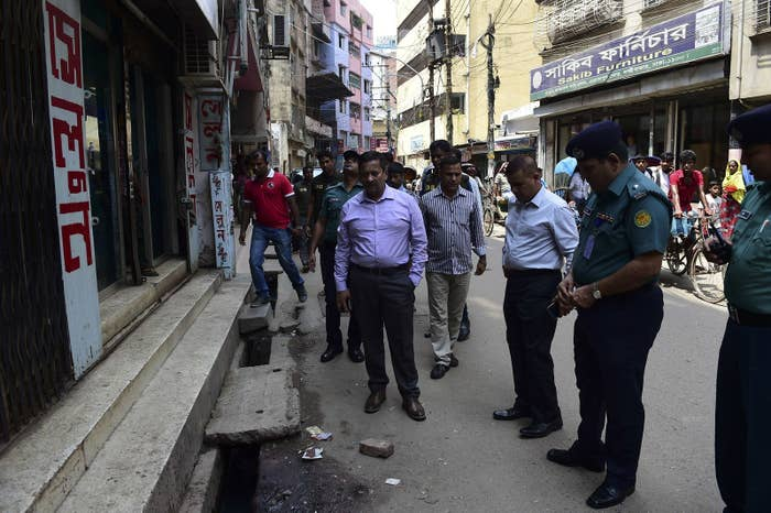 Police inspect the site of Samad's murder in Dhaka, April 7.