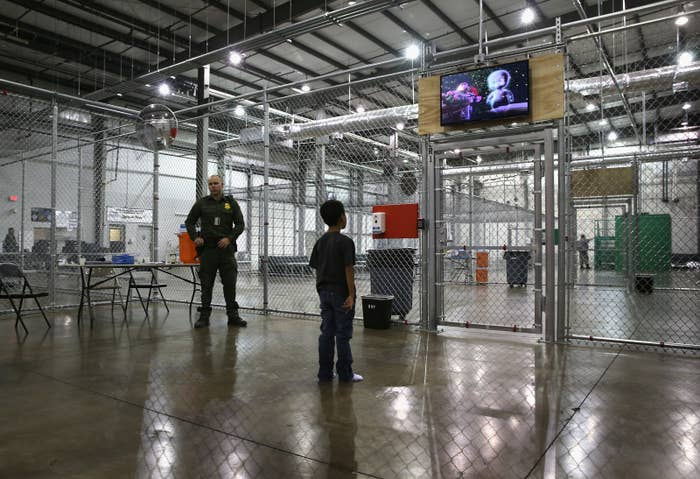 A boy from Honduras watches a movie at a detention facility run by the U.S. Border Patrol in Texas.