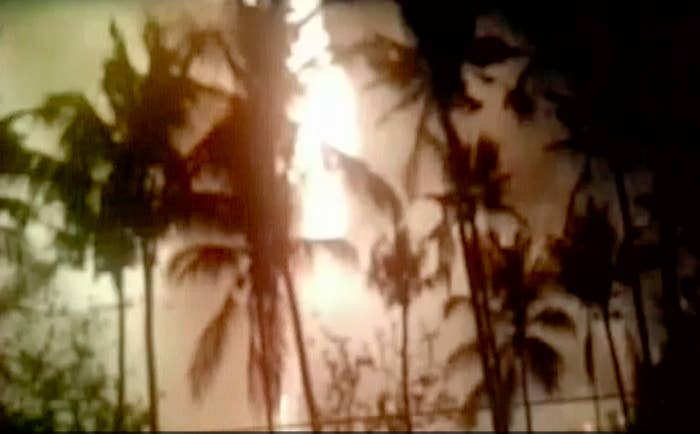 An image from video purporting to show fire works and smoke that were involved in a deadly fire Sunday in southern India.