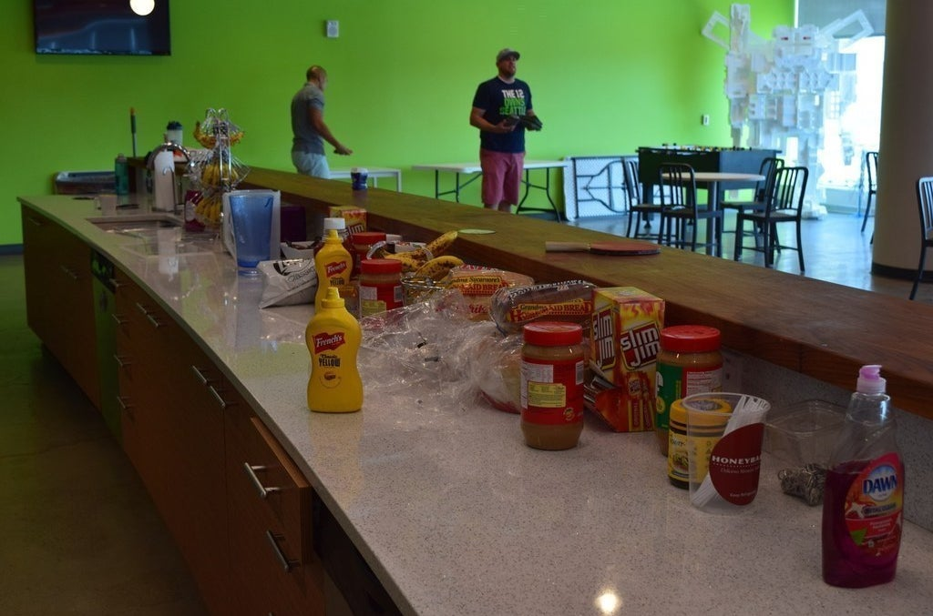An array of snacks and cornhole players at the Instructure headquarters in Cottonwood Heights, Utah.