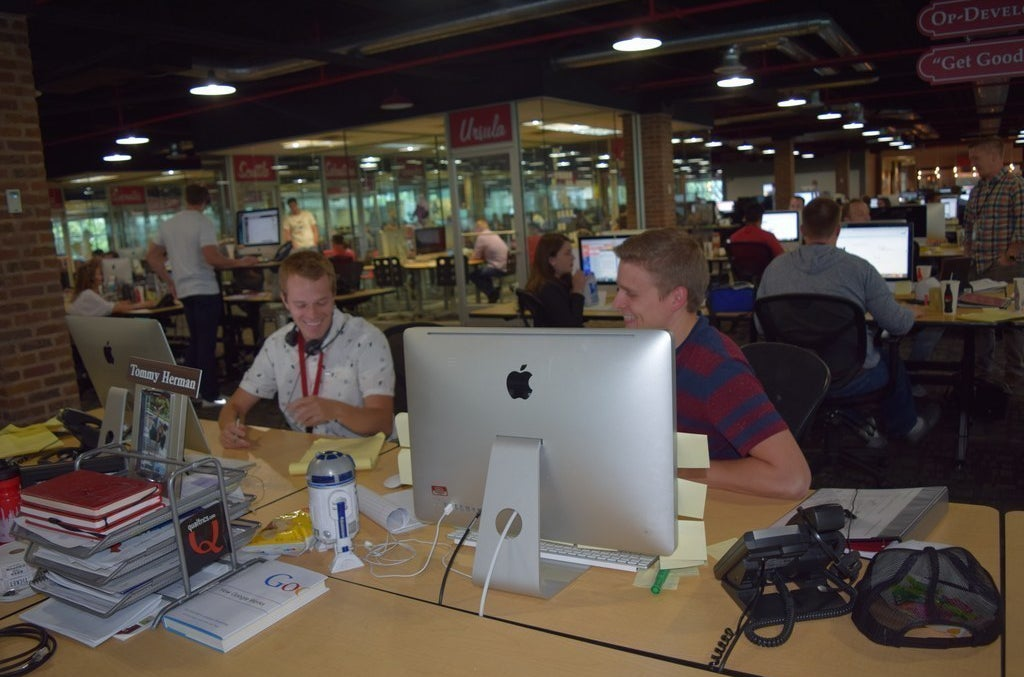 Workers at the Qualtrics office in Provo, Utah.