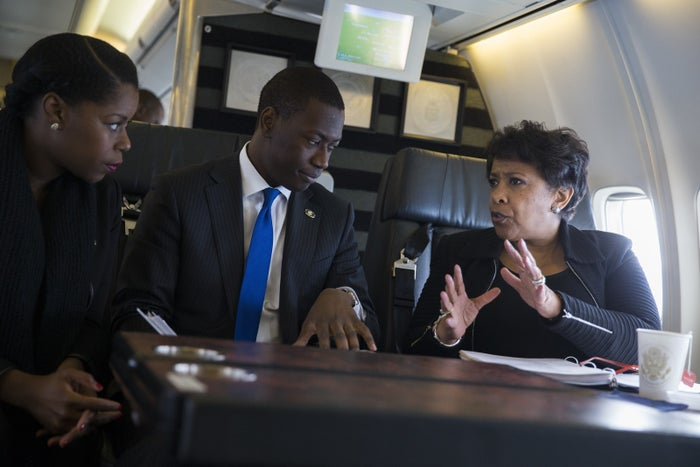 Attorney General Loretta Lynch, right, talks with her deputy chief of staff Shirlethia Franklin, left, and counselor James Cadogan during a flight to the Talladega Federal Correctional Institution in Talladega, Ala., on Friday, April 29, 2016.