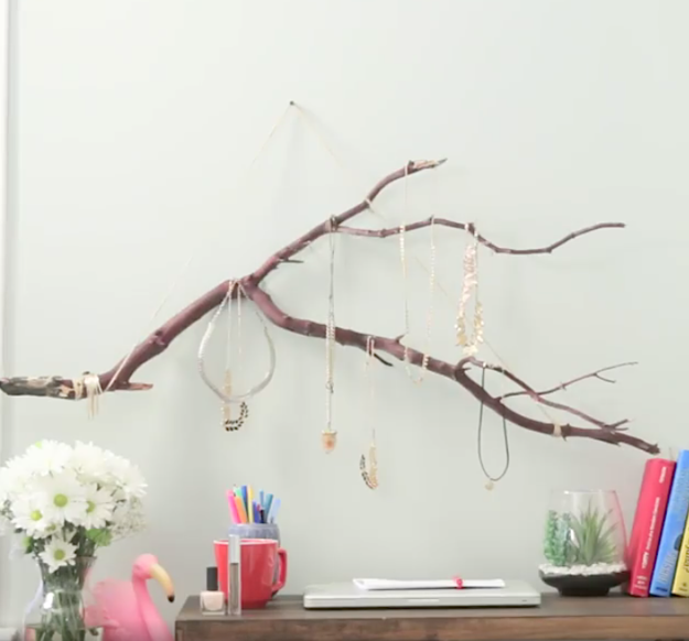 Make your own version of this $99 jewelry holder for the price of some twine and spray paint.