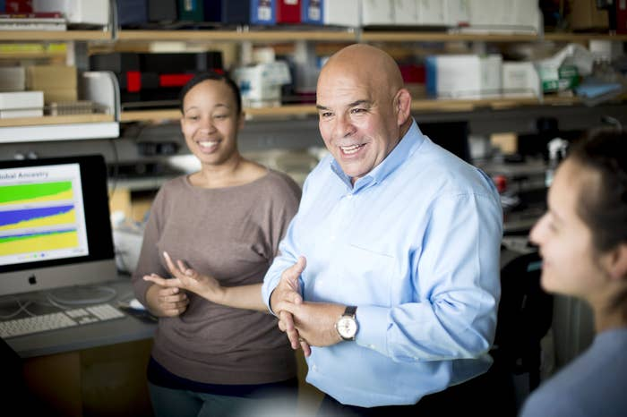 In his UCSF lab, Esteban Burchard (center) speaks with researchers Marquitta White (left) and Maria Contreras (right).
