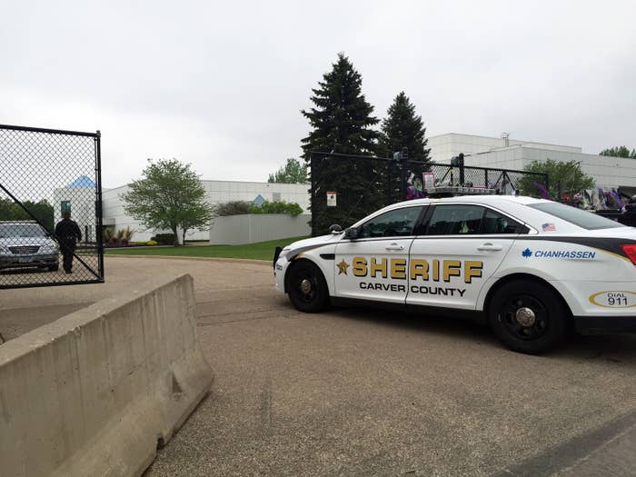 A Carver County sheriff's vehicle enters through the gates of Prince's Paisley Park home and studio on Tuesday.