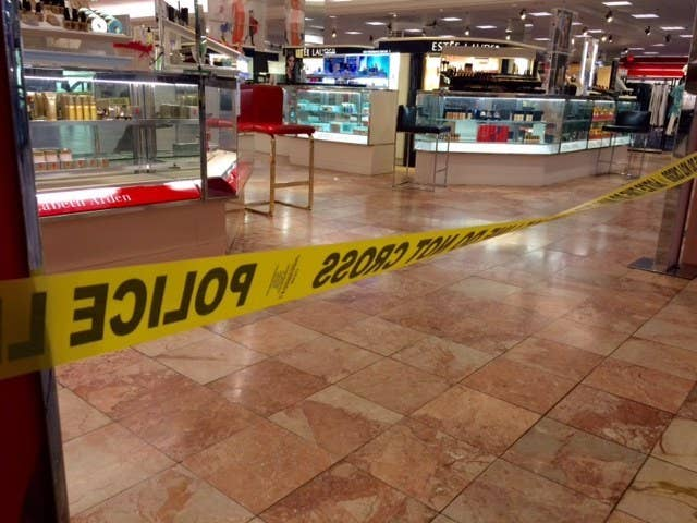 Crime scene tape is seen inside the Macy's at the Silver City Galleria mall.