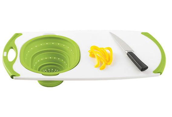 The strainer will pop down from either side of the board, so you can designate the back for veggies and the front for meat. Get it from The Container Store for $29.99.