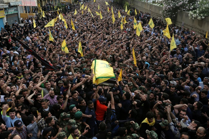 Hezbollah members carry the coffin of Badreddine.