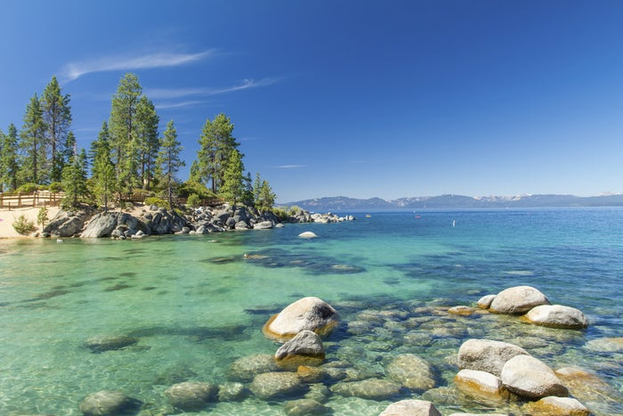 The shore of Lake Tahoe, spanning the border of California and Nevada, is lined with tons of gorgeous beaches perfect for swimming. The calm waters are also perfect for stand-up paddleboarding.