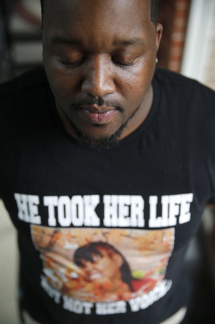 Martinez Sutton wears a shirt commemorating his sister, Rekia Boyd