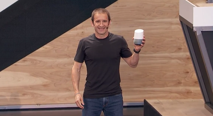Mario Queiroz holds a Google Home on stage at Google I/O.