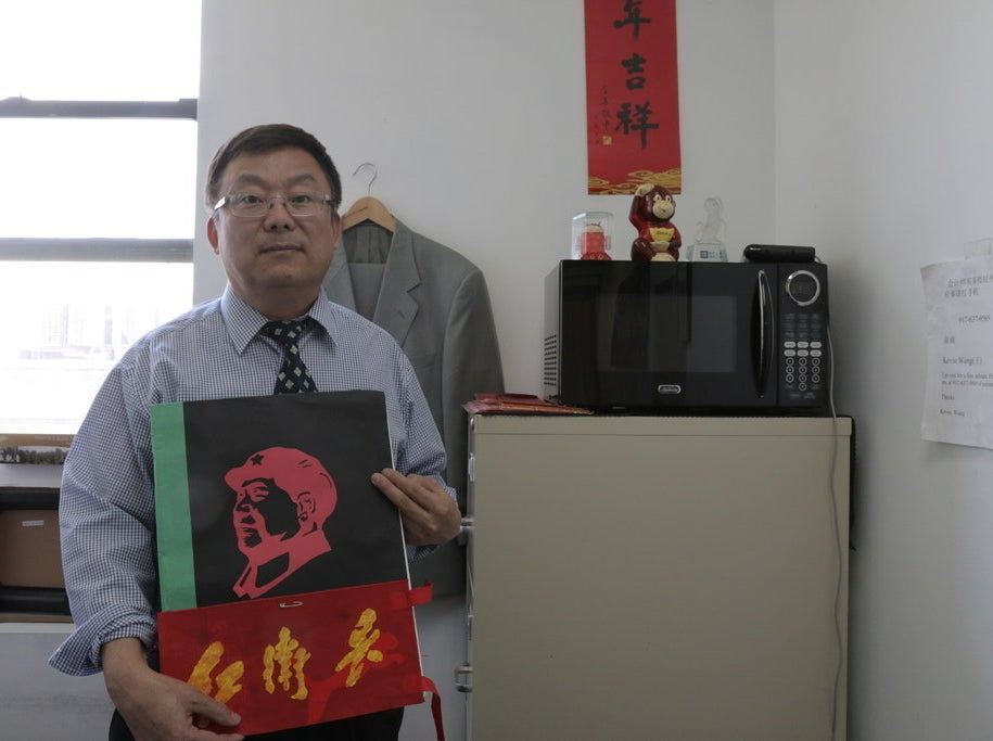 "Wang with his picture book on ""Red Guards"" life"