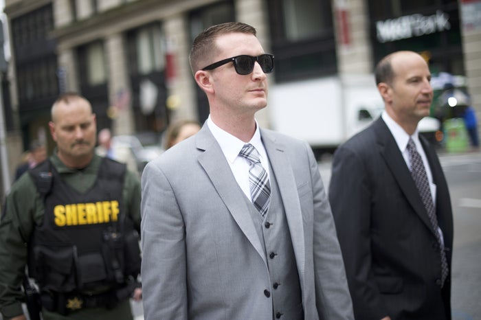 Edward Nero, a Baltimore police officer who was involved in Freddie Gray's arrest, exits the Baltimore City Circuit Court with his attorney Marc Zayon, after the first day of his trial on May 12, 2016.