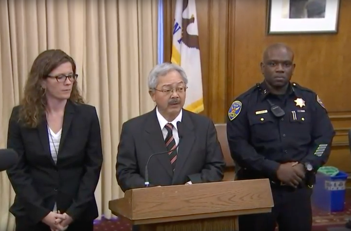 San Francisco Mayor Ed Lee speaks with acting police chief Toney Chaplin, right.