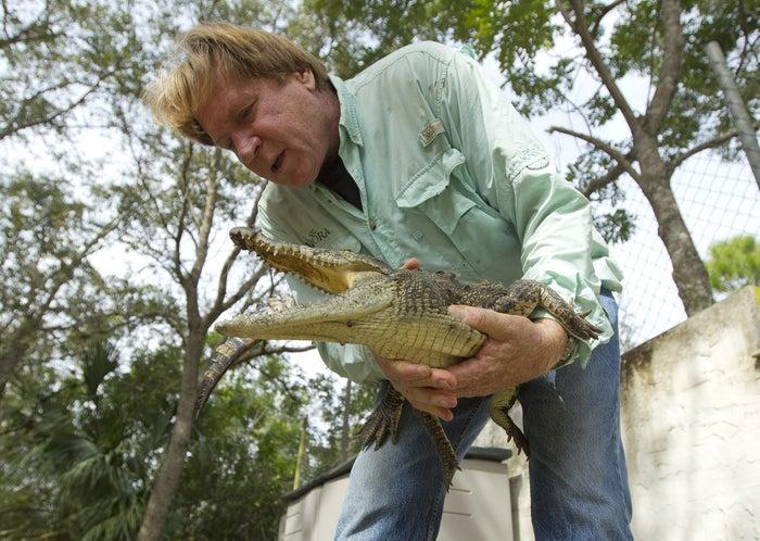 Joe Wasilewski with a captured Nile crocodile in Florida in 2012.