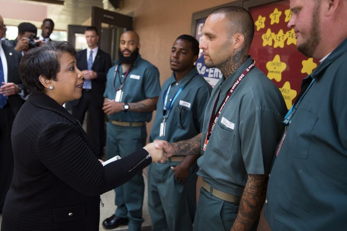 Attorney General Loretta Lynch, left, shakes hands with Derrick Cash during a visit to Talladega Federal Correctional Institution on Friday, April 29, 2016, in Talladega, Ala.