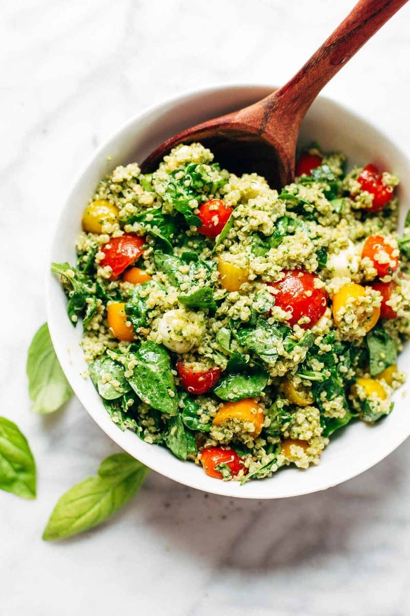Adding cooked whole grains like quinoa to leafy green salads adds healthy carbohydrates and a little bit of protein so you'll stay full until your next meal. Recipe here.