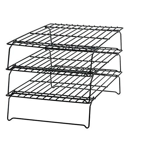 """Gets those cookies to eating temperature a lot faster than if they'd simply cooled on the baking sheet. Let's be honest here—the faster I can eat them the better!""— Christina KGet a three-tier rack for $9.99."