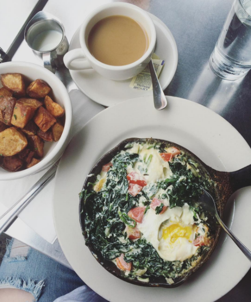 The Creamy Spinach Florentine Baked Eggs and Crispy Potatoes from Cornerstone Cafe.