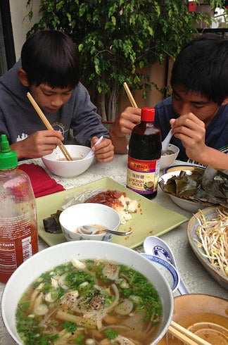 My younger brothers, Nathan and Nicholas, eating phố.