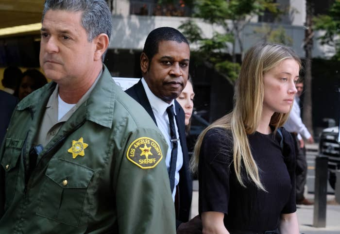 Actress Amber Heard leaves Los Angeles County Superior Court on Friday after giving a sworn declaration for restraining order against Johnny Depp.