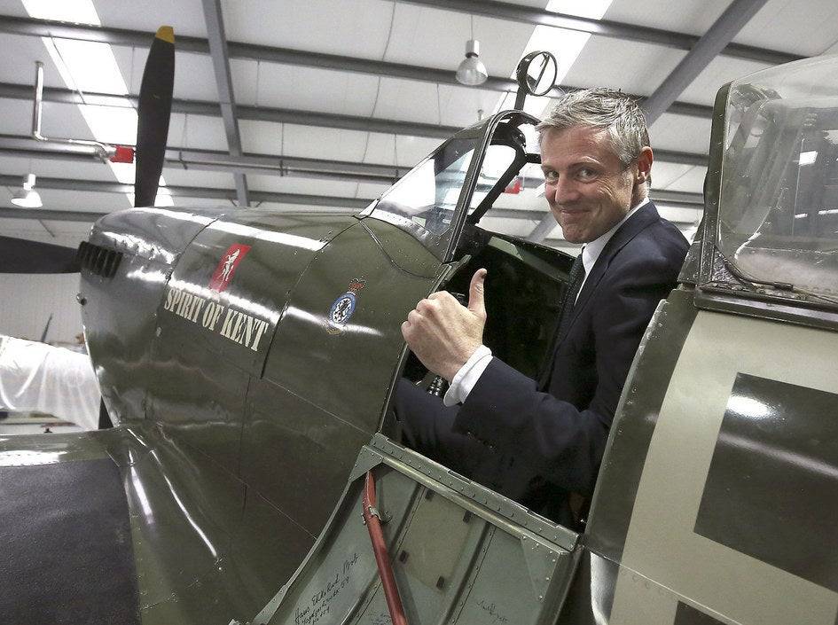 Conservative candidate for London Mayor Zac Goldsmith sits in a Spitfire plane during a tour of Biggin Hill Heritage Hangar in south east London.