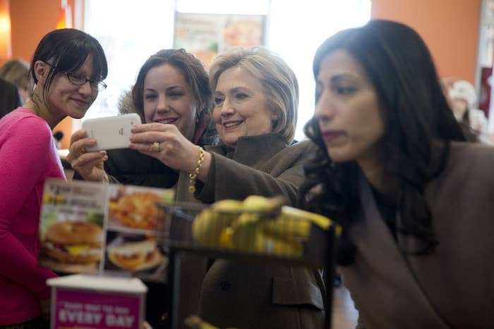 Huma Abedin, right, visits a Dunkin' Donuts with Hillary Clinton in Manchester, New Hampshire, on Feb. 7.