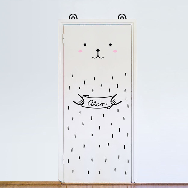 A customizable bear to stick to a door.