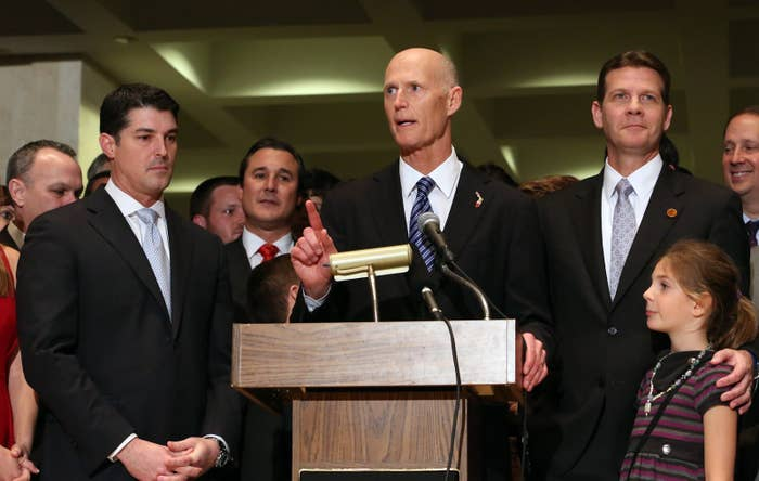 Gov. Rick Scott addresses the crowd flanked by House Speaker Steve Crisafulli, R-Merritt Island, left, and Senate President Andy Gardiner, R-Orlando, at the end of session, on Friday, March 11, 2016, in Tallahassee, Fla.