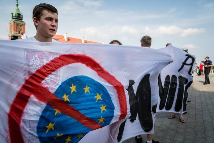 Polish far-right activists hold an anti-EU banner
