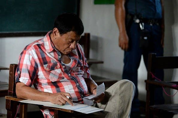 """Rodrigo Duterte casting his vote in Davao City. """"Many Filipinos are fed up. That's why they are turning to candidates who promise an iron fist or a return to the glory days of a dictatorial past,"""" the New York Times writes."""