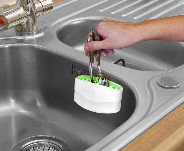 A cutlery cleaner that suctions to the side of your sink.