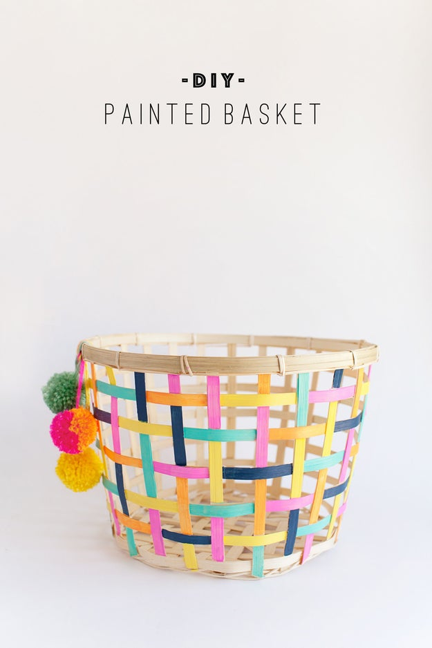 Paint a basic basket with your favorite color combo and use it to store blankets or shoes.