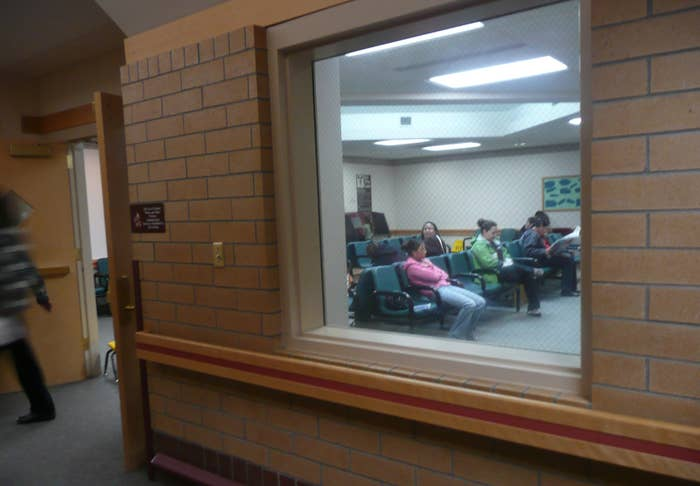 People sit in the waiting room of the Indian Health Service clinic in Crow Agency, Montana, in 2008.