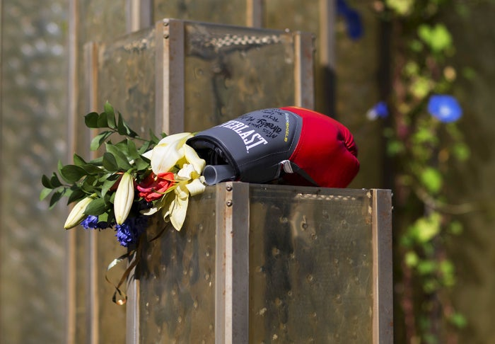 Flowers and a boxing glove are left at a makeshift memorial to Muhammad Ali at the Muhammad Ali Center in Louisville, Kentucky. The president of Turkey and the king of Jordan joined the long line of world leaders, religious figures, and superstars set to speak at Ali's funeral on Friday.