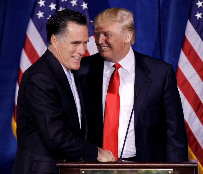 Donald Trump greets Mitt Romney during a news conference Feb. 2, 2012, in Las Vegas.