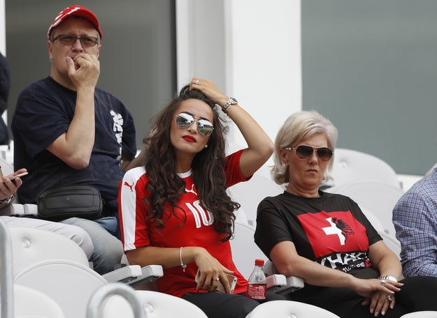 If you're Elmaze Xhaka, mother of Granit Xhaka, who plays for Switzerland, and Taulant Xhaka, who plays for Albania, you wear one T-shirt for both teams, that's what.