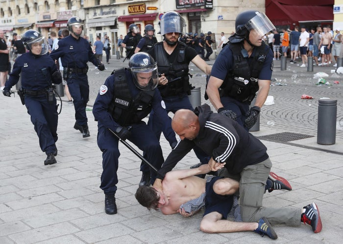 A man is apprehended by French police in downtown Marseille on June 10.