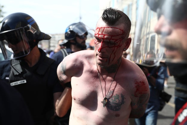 Several people were arrested and injured, according to police, who used tear gas and water cannons to break up the bottle-throwing rioters.