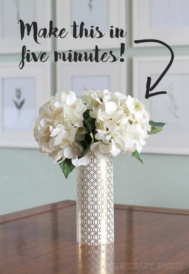 Tape a piece of scrapbook paper around a glass vase to make it look $$$.