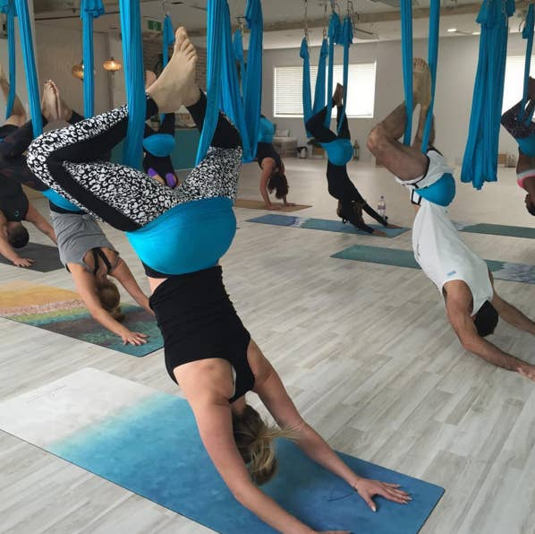 Heres everything you need to know before trying aerial circus classes in an aerial yoga class youx27ll do variations on typical yoga solutioingenieria Gallery