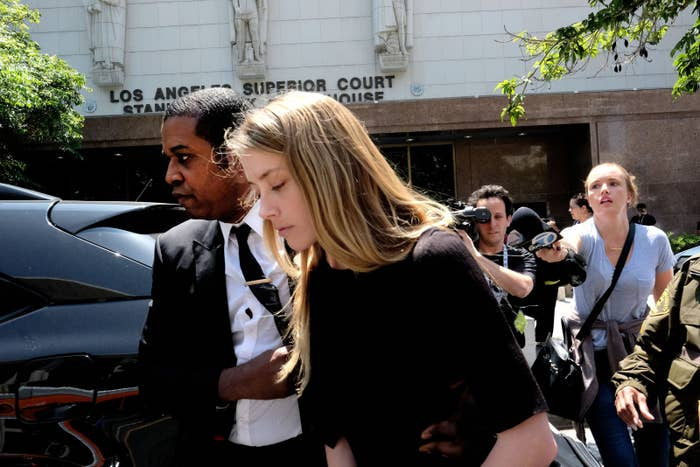 Amber Heard leaves Los Angeles County Superior Court in May.