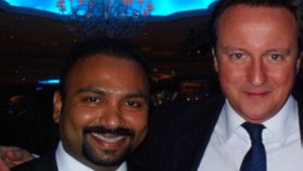 Subaskaran Allirajah (left) with David Cameron at the Conservatives' Black and White party in 2015.