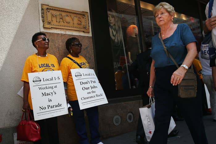 Macy's workers and union activists hold a demonstration outside of the retailer's flagship store at Herald Square in Manhattan on June 2, 2016 in New York City.
