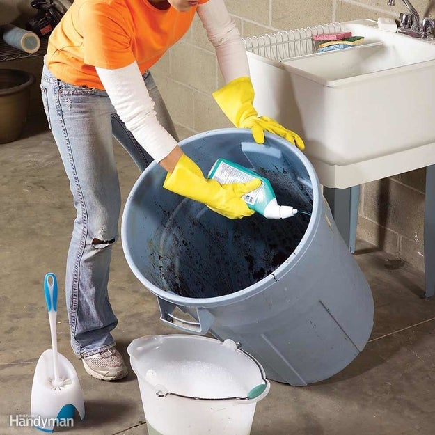 Use toilet cleaner and a toilet brush on your garage trash cans, then rinse well with a hose.