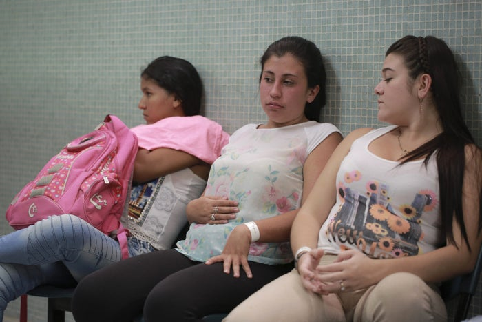 Daniela Rodriguez, 19 and six weeks pregnant, sits between two other pregnant women as they wait for test results after being diagnosed with the Zika virus at the Erasmo Meoz Hospital in Cucuta, Colombia.