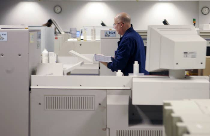 An ADP employee in the payroll check printing area at the company's plant in Parsippany, N.J.