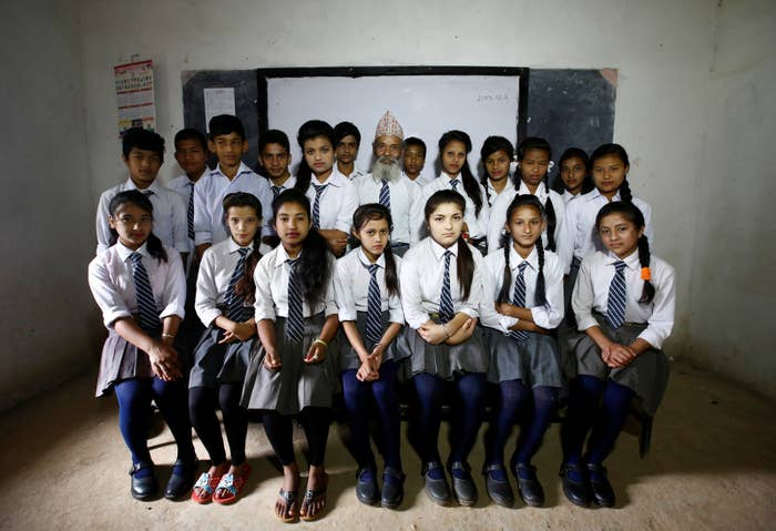 Kami, center, and his classmates.