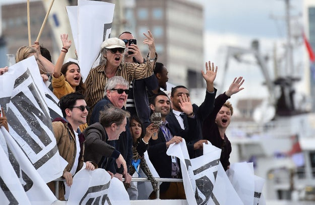 Here's Geldof, surrounded by supporters, making what is in Britain a very rude hand gesture.